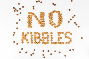 NO KIBBLES, formed using actual dog food kibbles