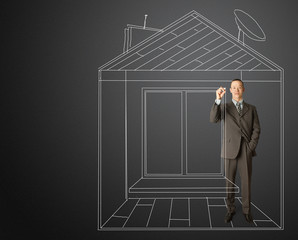 asian businessman with marker in fictional house