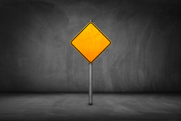 Street Sign: blank yellow road sign with street wall