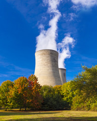 Cooling towers spew clouds into the atmosphere