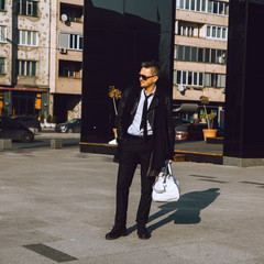 Square full length photo of business man in trendy suit outdoors