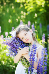 beautiful girl with lupines