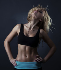 Sport  blond woman with perfect abc and well trained body .