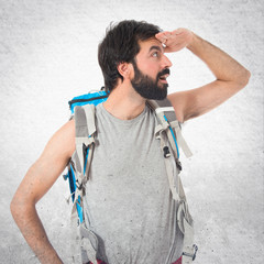 backpacker showing something over white background