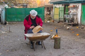 Ukrainian peasant doing daily work