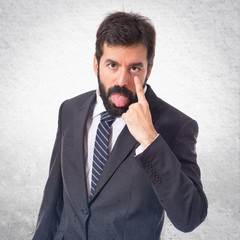 Businessman making a joke over white background