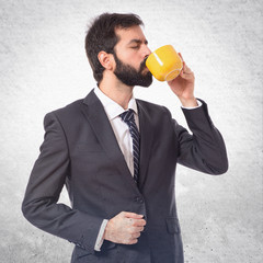 Businessman drinking coffee over white background