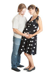 happy young man and his pregnant wife