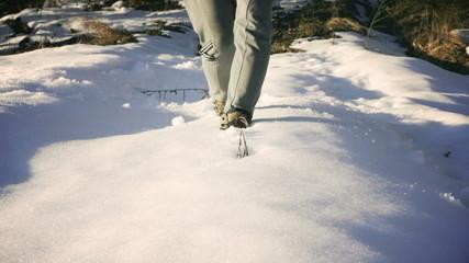 Woman going down on deep snow, steadycam shot, slow motion shot