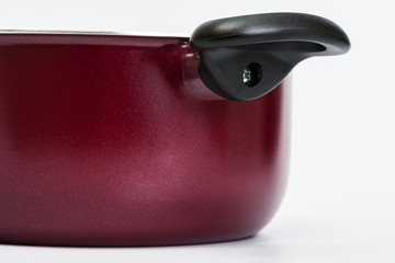 black handle red pan