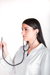 Beautiful brunette woman doctor with stethoscope examining
