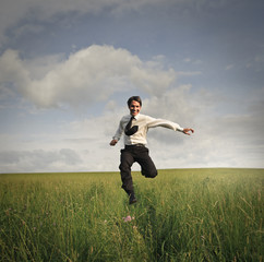 Businessman running in a field