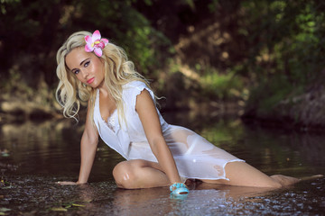 Sexy girl lying in the river.