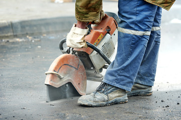 construction worker with cut-off machine