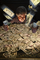Greedy man playing with heap of money