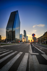 Italy, Lombardy, View of Milan skyline at sunset