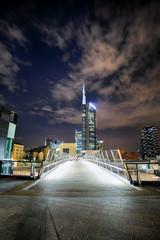 Italy, Lombardy, Milan, View of illuminated Milano Porta Nuova