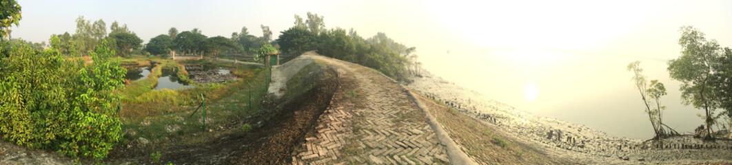 India, West Bengal, Sunderbans Delta, Bali Island, View along footpath on embankment