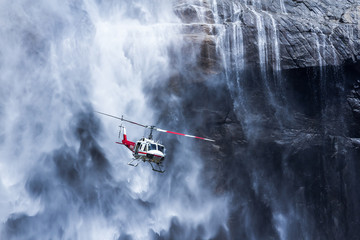 USA, California, Yosemite National Park, Helicopter at Yosemite Falls