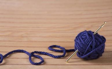 Ball of yarn with crochet needle