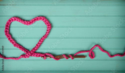 A crochet chain in the shape of a heart - 78454969