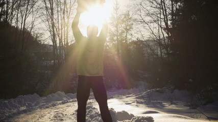 Man holding heavy snowball, steady, slow motion 240fps