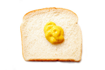 Yellow Mustard on a Slice of Bread