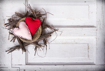 Two felt hearts in a nest