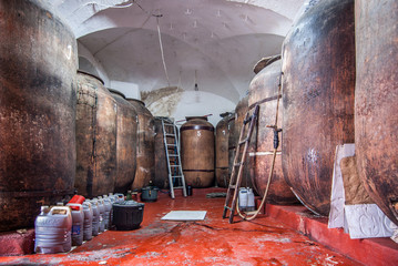 traditional wine cellar with barrels in disrepair