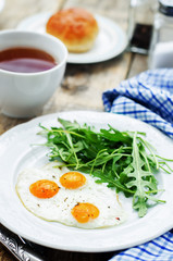 fresh breakfast with scrambled eggs and arugula