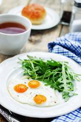 fresh breakfast with scrambled eggs and arugula