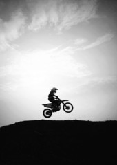 Silhouette of motocross in action