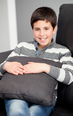 Smiling preteen on the sofa at home