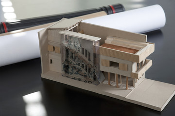 Plans and building model on table