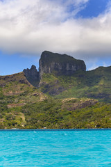 Azure lagoon of island BoraBora, Polynesia. Mountains,