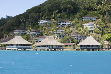 Hill slope by the sea and lodges on a slope. Polynesia...
