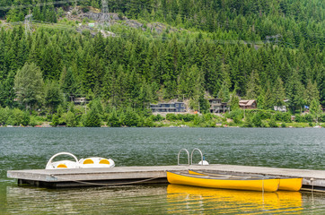 Canoes Moored to a Wooden Jetty on a Lake