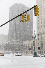 USA, Michigan, Detroit, Stoplights over crossroad in snowfall