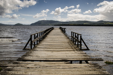 Chile, Chiloe Island, View along wooden pier in lake