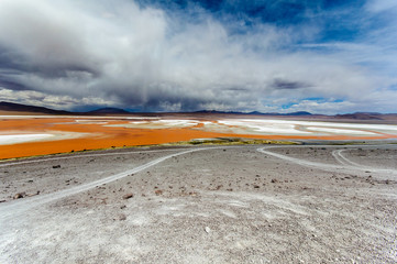 Bolivia, Altiplano, Landscape with cloudy sky above Red lagoon