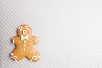 Happy gingerbread man over light grey textured background