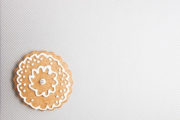 Gingerbread cookie over light grey textured background