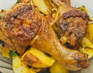 plate with roast chicken and potatoes