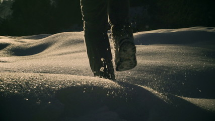 Woman walking on deep snow and cave, steady, slow motion 240fps