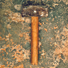 Hammer on weathered surface