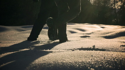 Couple walking together on deep snow, steady, slow motion 240fps