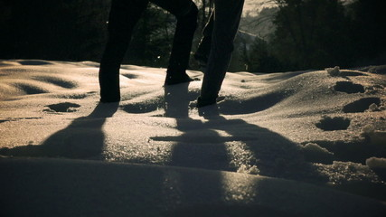 Couple walking together on the snow, steady, slow motion 240fps