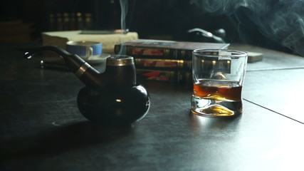 Tabacco pipe, smoke and whiskey