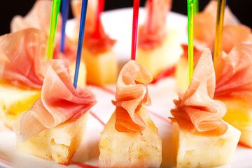 Canape with meat and pineapple.