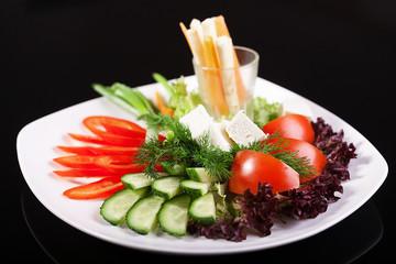 Fresh vegetable salad on a black background